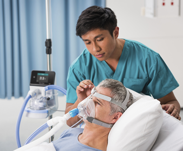 Medical staff ensuring the F&P 950 Humidifier is at a comfortable temperature for NIV patient