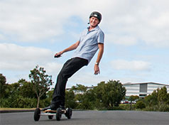 Fisher & Paykel Healthcare employee riding a powerboard