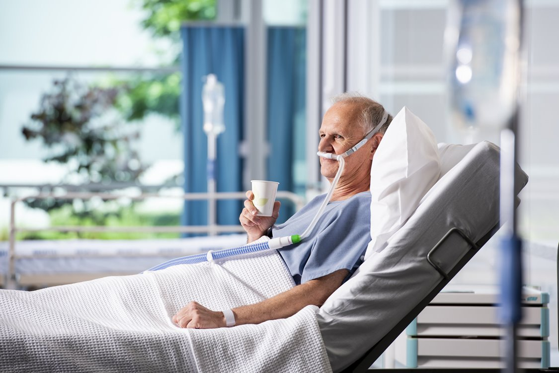 Patient sitting comfortably in hospital using Optiflow